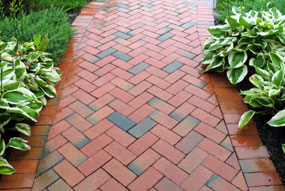 Newly Installed Paver Walk And Patio In A Brick Color With Weave Pattern